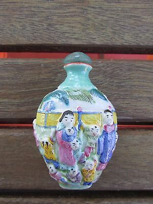 Signed Chinese Porcelain Snuff Bottle w/ Raised Character Scenes Children Old