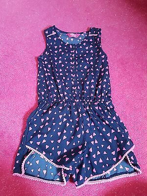 Girls Navy Playsuit with Pink Heart Print - size 7-8