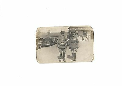 WW1 PC of 2 Senior 0fficers with black armbands waiting at railway station ?
