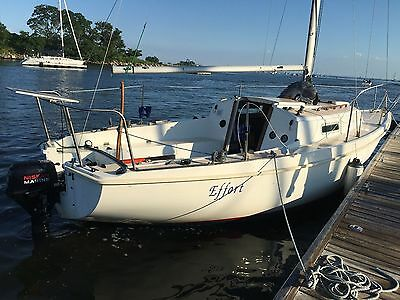 1976 Pearson 26 Sailboat with trailer and newer Nissan 9.8hp motor.