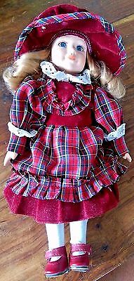 Vintage porcelain doll with Tartan outfit