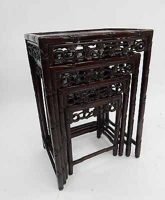 Set of (4) Antique Chinese Intricately carved Rosewood Nesting Tables.