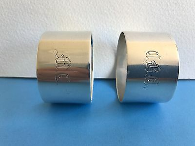 SOLID SILVER PAIR OF NAPKIN RINGS HALLMARKED SHEFFIELD 1907 and 1911