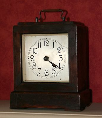Antique travel alarm clock wood case.