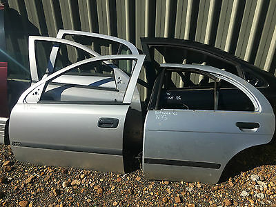 Nissan Pulsar N15 Silver Lhr / Left Hand Rear Door Shell. Paint Code: W