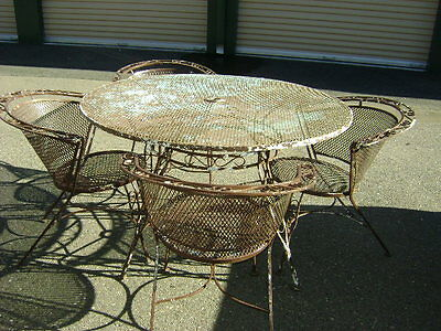 wrought iron patio table and 4 chairs set