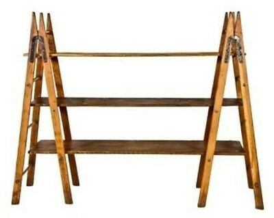 Bookself Supported By A-Frame Goshen Ladders With Wood Dowel Rungs