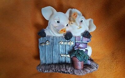 Two Pigs At Fence Figurine