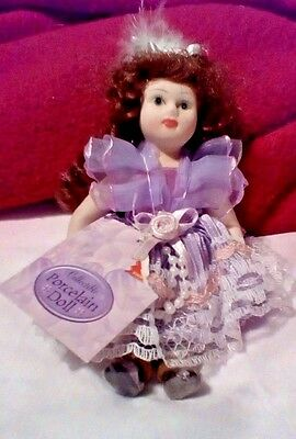 Small Collectible Porcelain Doll w/ Movable Limbs Brunette Hair Purple Dress NEW