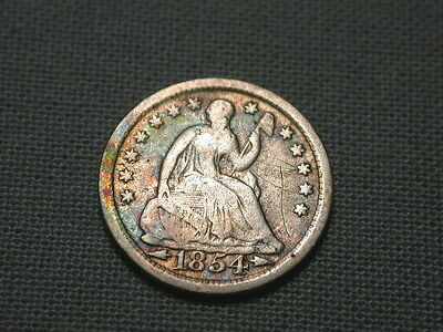nice silver 1854 SEATED LIBERTY HALF DIME with arrows