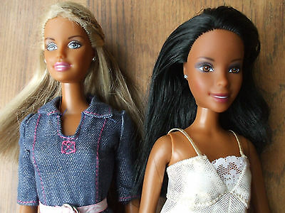 Ethnic Barbie x 2 with clothes.