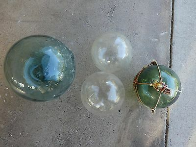 A Collection of 4 Authentic Vintage Glass Fishing Floats / Buoys