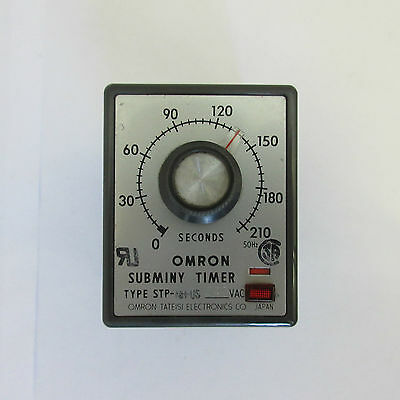 Omron STP-NH-US Subminy timer, with base.
