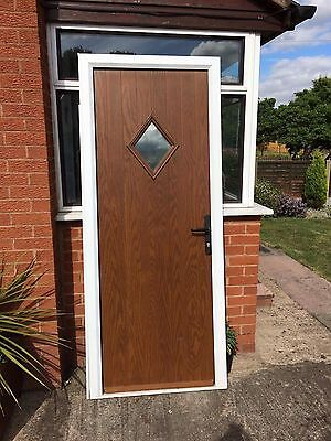 Composite door and frame picclick uk for Wooden back door and frame
