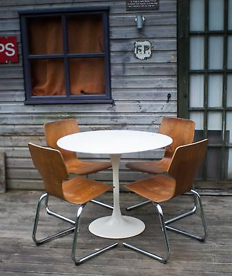 Tulip table and 4 stacking bentwood dining chairs.