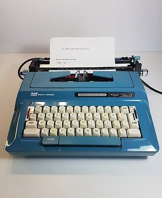 Smith Corona Sterling Automatic 12 electric blue Typewriter with original case