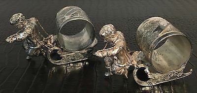 Antique BOY pull SLED Wilcox PAIR silver/silverplate figural napkin ring/holders