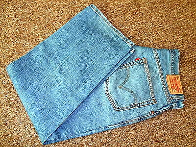 Vintage Levis 569 Blue Faded Loose Straight Denim Jeans Red Tab Zip Fly W33 L30