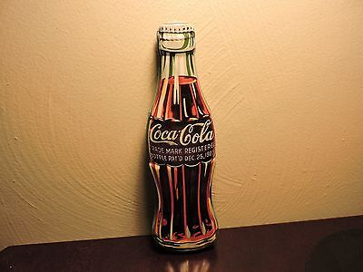 Coca-cola collectible pop bottle shaped tin. Great graphics-Looks like real Coke
