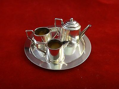 "English 1947 Birmingham 4pc Sterling Miniature Tea set. Pot is 1 1/8"" tall."