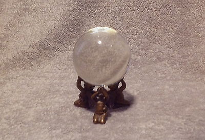 Antique glass crystal witch ball on brass figural triple cherubim stand