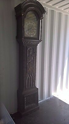 Magnificent carved Oak Longcase, brass arch dial face, inlaid star to case door.