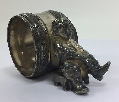 Victorian Silver Plate Figural Napkin Ring Boy Sitting on Stool Pulling on Boot