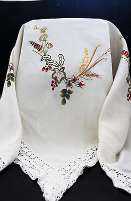 Vintage white tablecloth with hand embroidered flowers.