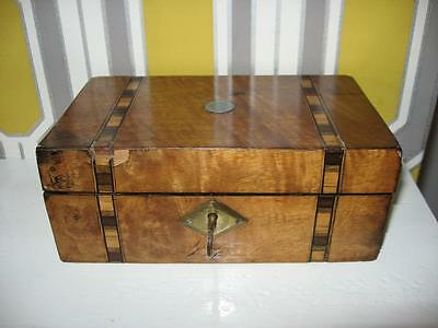 Unusual old wooden box with key