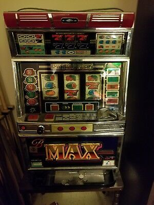 B Max Pachislo slot machine with tokens