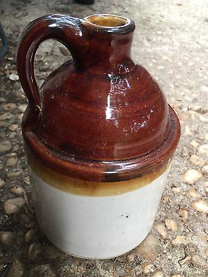"Whiskey jug, 8"" tall, made by Brown's pottery in Arden,NC"