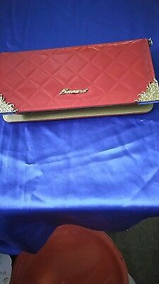 Patent leather, red quilted women's zip around wallet