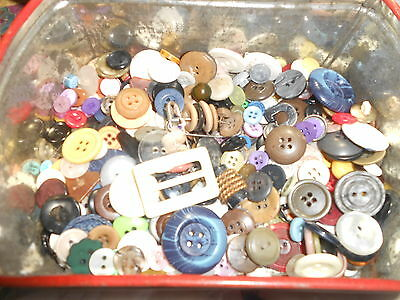 vintage and new buttons in a vintage tin..