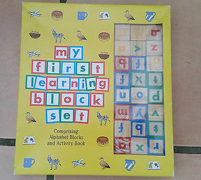 Kids alphabet wooden blocks learning educational toy set. Kids learning game.