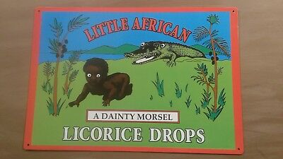 Little African licorice drops tin sign 12x17