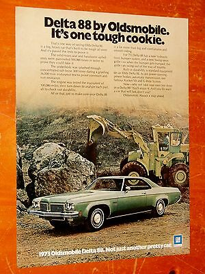 Green 1973 Oldsmobile Delta 88 Coupe Ad With Terex Tractor - Vintage American
