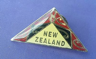 New Zealand triangle badge black & read maori tribal pattern