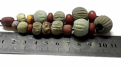 Ancient beads.19 ancient egyptian faience beads.1400 BC several sizes.
