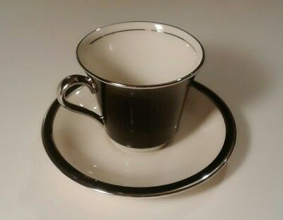 New 4 piece American Manor China EBONY cup and saucer set.