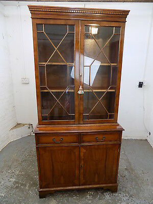 cabinet,books,cupboard,small,bookcase,glazed doors,drawers,shelves,cornice