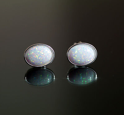 925 sterling silver stud earrings with 6 x8 mm white oval opal stones