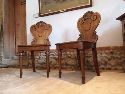 Chairs pair of William IV carved Oak hall chairs c1835