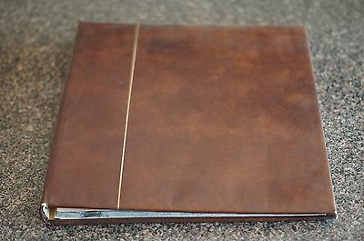 Kabe leather feel padded album with 5 new stock sheets Nice condition - used