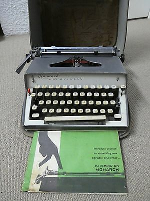 A Vintage Remington Monarch Typewriter - includes original case and manual.
