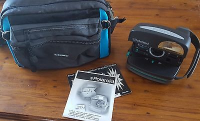 Polaroid 600 Camera With Manual And Camera Bag.