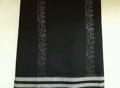 Black wedding saree with silver cut out hole embroidery.blouse included
