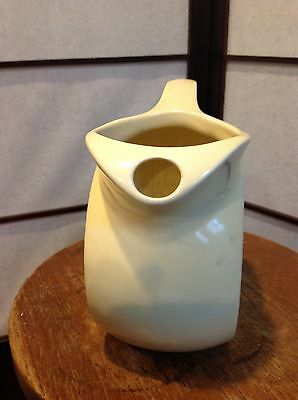Glased water pitcher , vintage , made in the USA . Possibly a HALL .