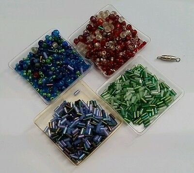 Seed and bugle beads in red green and blue.