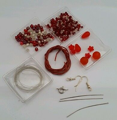 Bead kit with glass beads in red and orange tones