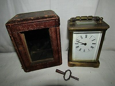 Antique cased carriage clock with key late 19th/early 20th century, original